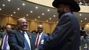 Sudan's President Omar al-Bashir, left, greets South Sudan's President Salva Kiir at African Union talks in Ethiopia. 15 July 2012