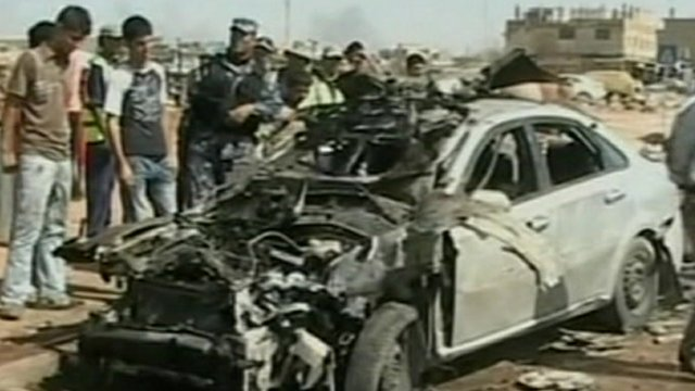Burnt out car in Iraq attack