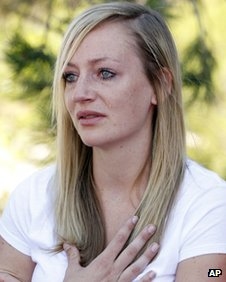 Amanda Lindgren cries as she speaks about boyfriend Alex Teves at the court in Centennial, Colorado on 23 July 2012