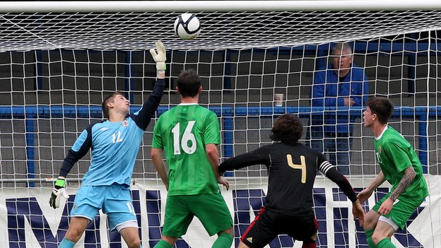 NI keeper Gareth Deane tips Antoni Briseno's header over the bar