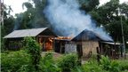 A house burns at Kachugaon village in Kokrajhar district, about 230 kms from Guwahati, the capital city of the northeastern state of Assam during violent clashes on July 23, 2012. P
