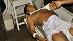 An injured Bodo personnel gets treatment in a hospital in Kokrajhar, India, Monday, July 23, 2012.