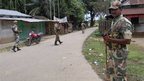 Indian security personnel patrol on a street during curfew near Kokorajhar town in the northeastern Indian state of Assam July 22, 2012.