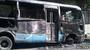 A burnt bus in the Qabun district in Damascus (22 July 2012.)
