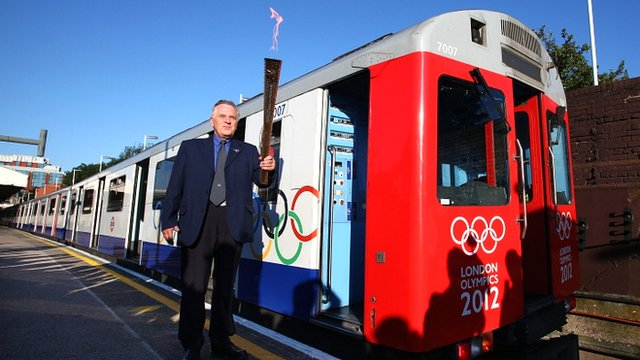 Service Operator John Light holds the Olympic torch