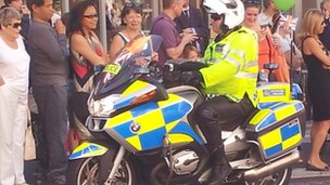 Police officer high-fiving the crowds