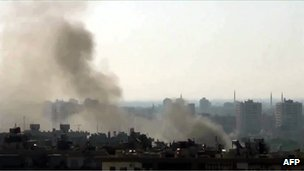 An image grab taken from a video uploaded on YouTube shows smoke billowing from the al-Mazzeh neighbourhood of Damascus, 22 July 2012