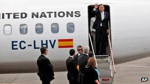 UN chief Ban Ki-moon waves after landing at Pristina airport, 24 July