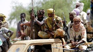 Rebel fighters in Darfur. File photo