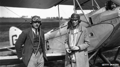 Amelia Earhart and an unidentified man stand in front of a plane in an undated file picture