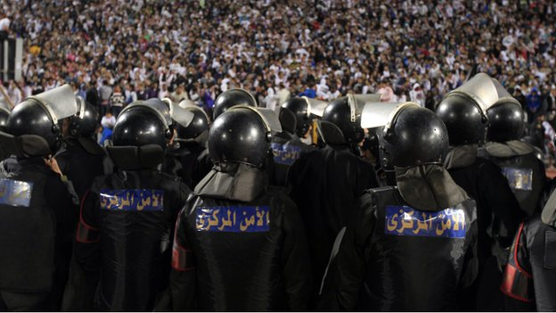 Egyptian police stand guard in Cairo stadium