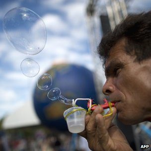 Activist blowing soap bubbles