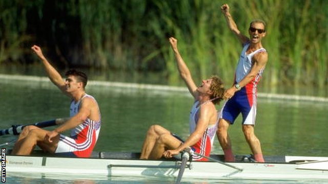 Greg Searle (left), his brother Johnny Searle (centre) celebrate with Gary Herbert (right) the cox all of Great Britain after winning the Coxed Pairs Rowing event at the 1992 Olympic Gmaes in Barcelona, Spain