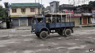 Indian army patrols street following ethnic clashes in Kokrajhar, Assam, 24 July 2012