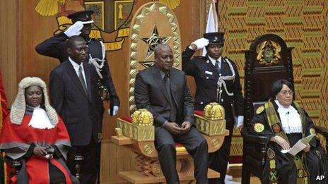 John Dramani Mahama (seated) is sworn in as President of Ghana