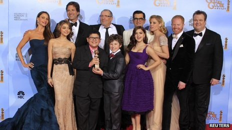 The cast of Modern Family pose with their Golden Globe in January 2012