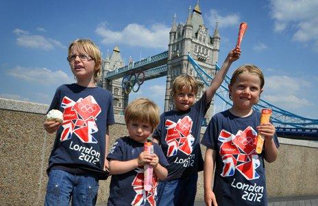 Boys wearing London 2012 t-shirts near tower bridge