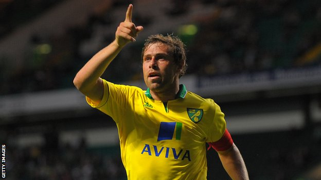 Grant Holt celebrates his winning goal at Parkhead