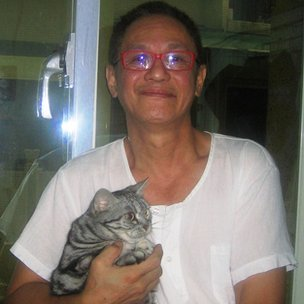 John Lin and his cat