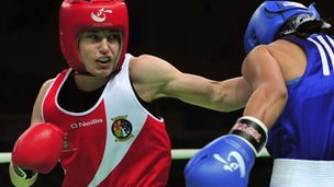 "Katie Taylor throws a punch at Saida Khassenova of Kazakhstan during their women""s 60 kg division fourth round match at the AIBA World Women""s Boxing Championships in China in May"