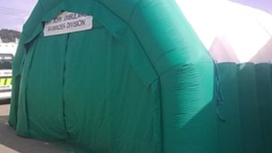 An inflatable tent