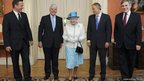 Britain's Queen Elizabeth poses with Prime Minister David Cameron and former prime ministers