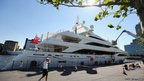 A luxury yacht is moored in South Quay on the Isle of Dogs