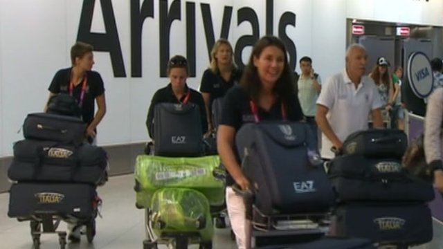Members of the Italian Olympic team arrive at Heathrow