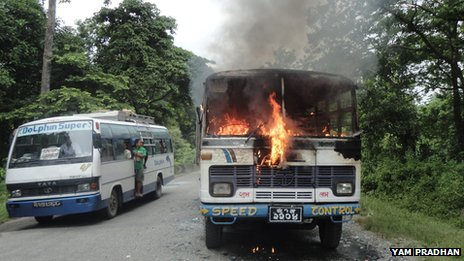 Bus attacked by activists burns in Nepal
