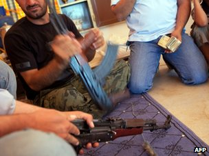 FSA fighters buy weapons and ammunition on the black market in Idlib province (6 July 2012)