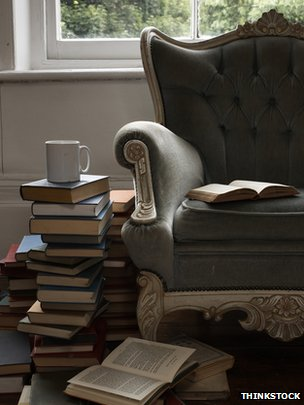 Pile of books and armchair 