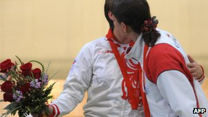 Nino Salukvadze and Natalia Paderina embrace at the 2008 Olympics
