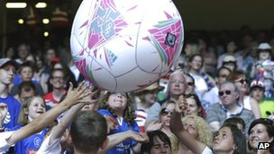 Fans play with a huge ball inside the Millennium Stadium