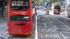 A bus next to an Olympic lane