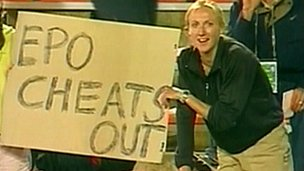 "(File photo 2001) Paula Radcliffe holds a sign saying ""EPO Cheats Out"""