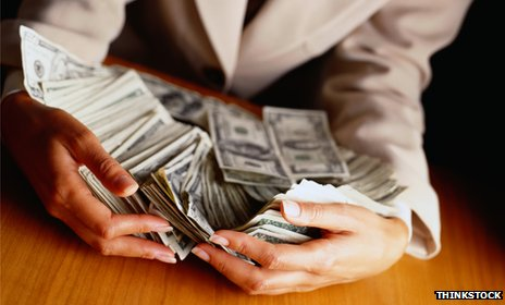 Woman's hands holding money