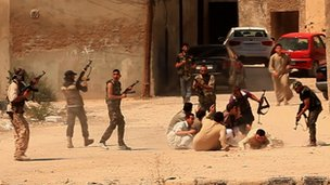 Rebels surround a group of alleged Assad supporters
