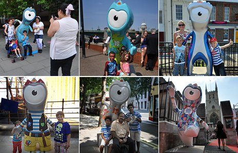 People pose with mascots