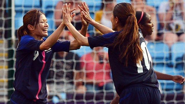 Japan's Nahomi Kawasumi (L) and Homare Sawa celebrate victory