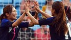 Japan's Nahomi Kawasumi (L) and Homare Sawa celebrate victory