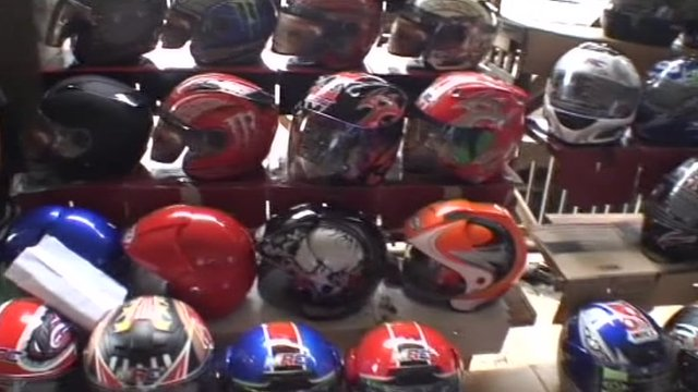 Motorbike helmets in a market in the Philippines