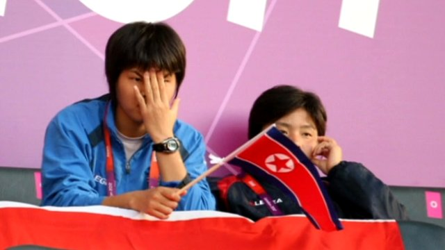 Spectators react to South Korean flag error