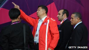 A North Korean Official gesturing to explain the wrong flag was being shown