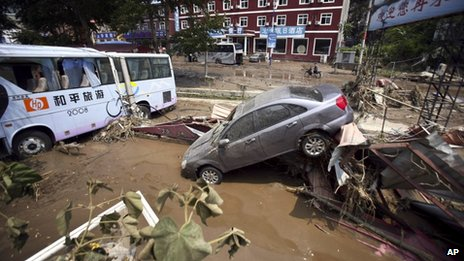 Vehicles damaged in a flood pile up off road in Yesanpo Scenic Zone, a resort near the capital Beijing, in Laishui county, in northern China's Hebei province.