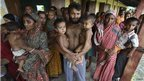 Villagers affected by ethnic riots, along with their children, are pictured at a relief camp near Kokrajhar town in the northeastern Indian state of Assam July 25, 2012.