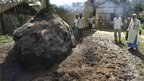 Villagers, affected by the ethnic riots, stand next to a heap of paddy straw that was burnt during the violence near Kokrajhar town, in the north-eastern Indian state of Assam July 25, 2012.