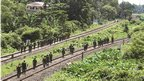 Indian army soldiers patrol through the railway tracks at Kokrajhar town, in the northeastern Indian state of Assam July 25, 2012
