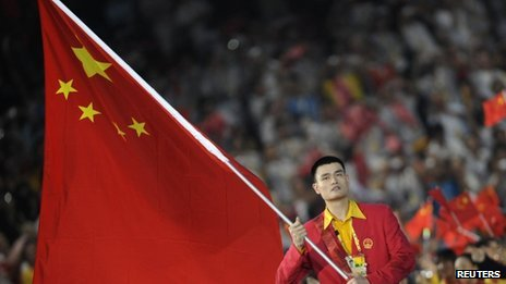 File photo of Yao Ming carrying the Chinese national flag during the opening ceremony of the Beijing 2008 Olympic Games