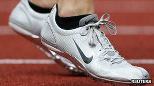 An athelete wears a pair of Nike shoes