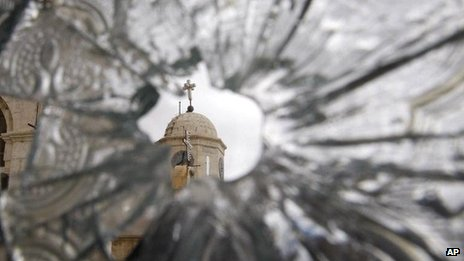 File picture of a church dome seen through the broken window of the Sednaya Convent  in Sednaya, north of Damascus
